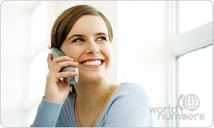 Smiling woman enjoying easy access to her World Numbers online dashboard using her mobile telephone device